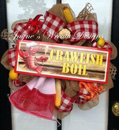 Crawfish Boil Wreath with corn, lemons, crawfish, crab, garlic and tabasco sauce bottles