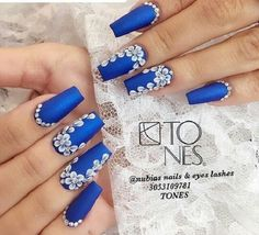 The Floral Blue and White Coffin Nail art Design. Floral blue and white nail art design on the matte nail polishes is the one for all the girly girls looking to embellish their hands while staying classy.