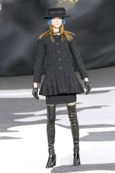 "Chanel Paris Fashion Week Fall 2013 - FLARET - ""Thigh-high leather socks and furry helmuts accessorized Chanel's muted palette and highly textured fabrics"""