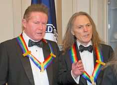 """Don Henley Photos Photos - Don Henley and Timothy B. Schmidt of the rock band """"Eagles"""" speak to one another as they prepare to join others of the five recipients of the 39th Annual Kennedy Center Honors pose for a group photo following a dinner at the U.S. Department of State in Washington, D.C. on Saturday, December 3, 2016.  The 2016 honorees are: Argentine pianist Martha Argerich; rock band the Eagles; screen and stage actor Al Pacino; gospel and blues singer Mavis Staples; and musician…"""