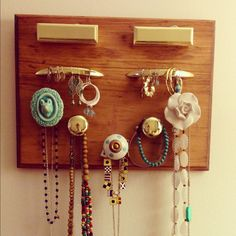DIY jewelry holder. Thank god for cute anthropologie knobs!