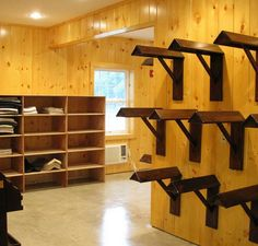 Saddle wall and saddle pad cubby of show team tack room