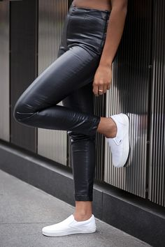 Our Favorite Slip-On Shoe, Remixed #refinery29 http://www.refinery29.com/vans-new-fall-slip-on-shoes#slide8 Have your canvas whites be the showpiece by pairing them with black cropped faux-leather skinnies.