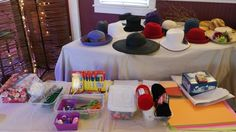"""Craft and Hat bar at our Mad Tea Party. This was a literary pre-event for NICE (Noblesville Interdisciplinary Creativity Expo) to get people brainstorming artistic ideas inspired by Alice in Wonderland. Participants were free to use paper, scissors, colored pencils, playing card, beads, and """"go mad."""""""