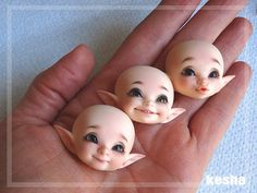 Not a really good picture (the faceup tints are drab because of my hand) , but It's funny to see how small they are ^u^ Faceups by me
