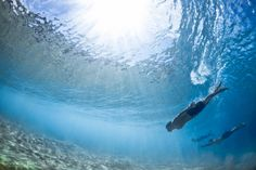 Swimmers beneath the sea. The Underwater Project by Mark Tripple