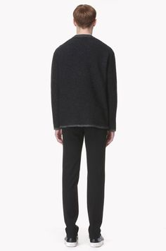 100% wool knit sweater. Small boucle textured material. Ribbed neckline. Zipped slits at each side of hem.</br>184cm tall model wearing size 100.