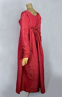 Silk faille, bib-front dress, c.1800. The ubiquitous sheer white dresses from the early 19th century give the impression the Regency wardrobe lacked color. What a special treat to find a Regency dress in rich cranberry-red silk faille! It is styled with a drop-front bodice, known as bib front. Under the bib front is an ivory cotton under bodice that closes with ties.