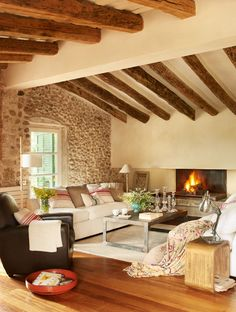 The house represents an amazing project that mixes different styles of homes, Ampurdán and Provence. In Girona, near the border of France, a couple from Barcelona bought an old barn and transformed it into a cozy home.  Modern and rustic styles complement each other beautifully. The walls are clad in knotty pine, and the fireplace gathers all the family together.