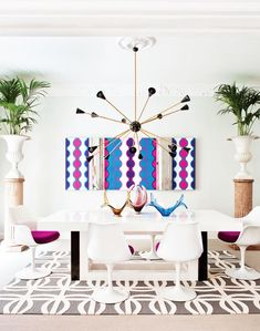 My eyes are on the gold/black light fixture, eclectic tulip chairs & grey/white pattern rug!