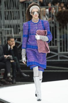 Chanel Fall 2017 runway show transformed the Grand Palais into a Space station. Metallic fabrics, space-inspired prints, glitter boots. Paris Fashion Week.