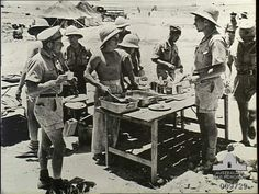 Royal Air Force and South African Air Force personnel lunch together in the Western Desert, North Africa.