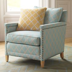 The nailhead trim is a perfect complement to the lines of the chair. Love the lattice print upholstery too!