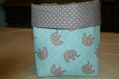 Check out this adorable cloth catch-all basket! What a great gift for a new baby! This basket is made with cotton fabric and Pellon Decor Bond as a stabilizer. This item measures approximately 5d x 6w x 7h, and was made in my smoke-free home. Want to personalize a basket? I can custom-make a basket and embroider a name or saying on the trim. Take a look at the Catch-all Custom Cloth Basket item in my shop: https://www.etsy.com/listing/535730434/catch-all-custom-cl...