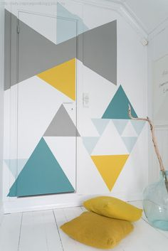I'm sticking it on this board because i love these colours, probably won't be painting the wall, but I can make everything else yellow, blue and turquoise! :) // DIY geometric wall paint job, as seen on design milk Geometric Wall Paint, Geometric Painting, Triangle Wall, Diy Wand, Geometric Graphic, Wall Patterns, Geometric Patterns, Geometric Shapes, Design Patterns