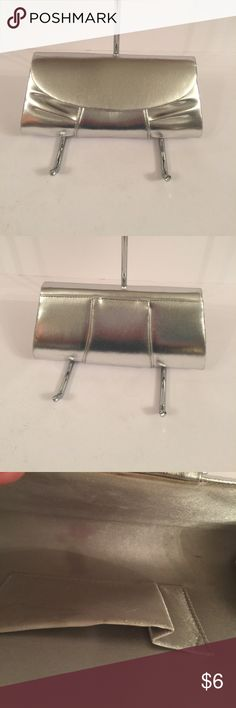 """Silver Clutch Evening Bag GUC it shows some wear on the inside where it opens. It measures approximately 9"""" long and 5"""" tall Bags Clutches & Wristlets"""