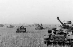Pzkw IV ausf.G on right and some Pzkw III of Totenkopf Division