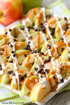 Delicious Caramel Apple Nachos - a quick and delicious treat perfect for movie night or your next party. { lilluna.com } Recipe includes apples, caramel, vanilla candy coating, mini chocolate chips, and heath toffee bits.