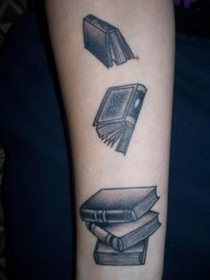 Books on forearm done by Brett Burnham at Electric Tattoo in Pasadena, Maryland.