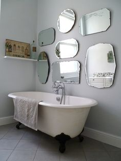 to hang a display of vintage mirrors frameless-mirror-wall-display. Also loving the soft grey and roll top bath with little shelf at the endframeless-mirror-wall-display. Also loving the soft grey and roll top bath with little shelf at the end Bathroom Mirror Design, Bathroom Styling, Bathroom Wall, Small Bathroom, Master Bathroom, Wooden Bathroom, Budget Bathroom, Bathroom Ideas, Brass Bathroom