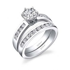 From our Allure Collection, this engagement ring features channel set round diamonds, and a hi-polished finish. A matching band completes the look. This distinguished ring will fit any lifestyle.