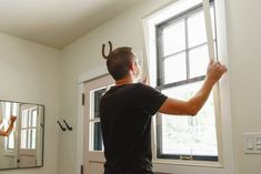Installing the indow insert in a vintage window // Indow Windows for comfortable, energy efficient homes via Yellow Brick Home Interior Storm Windows, Moulding And Millwork, Black Window Frames, Window Inserts, Energy Efficient Homes, Energy Efficiency, Bob Vila, Heating And Air Conditioning, Sound Proofing
