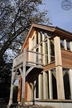 Glazed oak frame with balcony from master bedroom, by Roderick James Architects