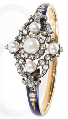 An Antique English 18 karat gold, diamond, natural pearl and enamel bracelet by Hunt & Roskell. The center piece removes and converts to be worn as a brooch . The bracelet comes with the original brooch attachment and the signed original box. Hunt & Roskell Circa: 1870.