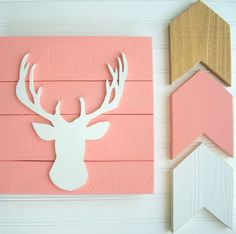 Antler wall decor looks great in a Woodland nursery , Tribal nursery or big girl room. This antler sign is the makes a perfect baby shower or new baby gift.  The COST of this LISTING is for OnE WOODEN ANTLER / DEER HEAD ( Coral pallet / White Antler ) sign ~*~*~*~*~*~*~*~*~*~*~*~*~*~*~*~*~*~*~*~*~*~*~*~*~*~   ~~~~ IF YOUD LIKE TO ORDER this in AnoTHeR CoLoR , DO NOT PURCHASE THIS LISTING :)  Instead, please contact me first to discuss colors .You can CLICK on the  CONTACT BUTTON  to the…