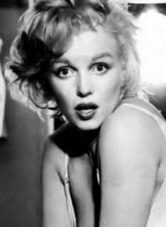 A rare shot of Marilyn Monroe during her photoshoot with Richard Avedon, 1957.