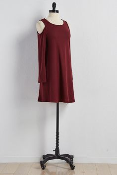 Crafted from a soft knit fabrication, this sweater dress features bare shoulders…