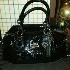 Coach Madison Patent Leather Sabrina Satchel Beautiful Small Coach Madison Patent Leather Sabrina Satchel...only used a handful of times, kept in duster bag...comes with duster bag...please ask all questions before purchasing.. Additional photos available upon request...all reasonable offers will be considered..please use the offer button I will not discuss pricing on the listing...thank you!! Coach Bags Satchels