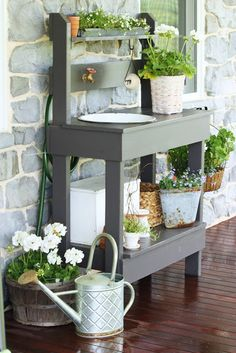 Potting benches can be conveniently located in the shade and next to a water source for easy use.  StoneGable