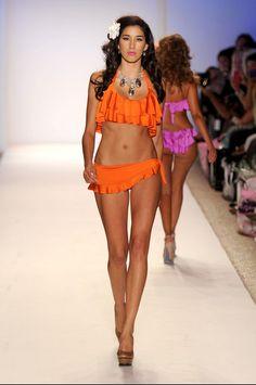 1a398faeba Nicolita's Rumba Ruffle Crop Top in Mango. These bikinis are ready for Cuba!