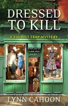 Dressed To Kill (2015) (The fourth book in the Tourist Trap Mystery series) A novel by Lynn Cahoon