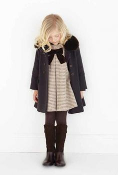 Tweed Birthday Party dress with black contrast bow and dark secret agent coat