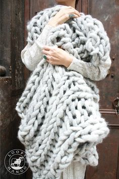 Super chunky knit blanket in gray merino made with Big Loop Yarn.  Available as a blanket, knitting kit or yarn from loopymango.com