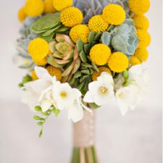 Like this bouquet, with the succelants and round yellow flowers. Not sure what those are