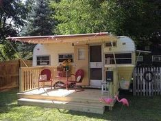 Live in #Vintage Style - Vintage #trailers are not only great for camping. Equipped with a full porch and seating for two, this picturesque #RV could make the perfect simple getaway home. Set with decorative party lights, it is a cozy and unique way to live.