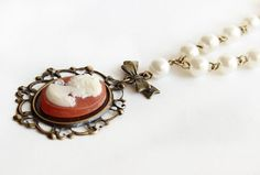 Lady cameo on antique bronze filigree pearl by asteriascollection, $20.00
