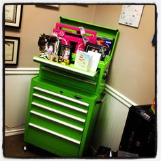 a salon I went to in Dallas had a stylist that used a rolling tool box like this at his station to keep his tools/products organized.. great idea!