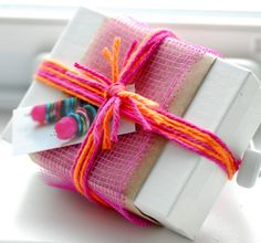 Gift Wrap, Packaging: love the bright  yarn, mesh, craft paper combo