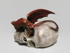 """Dragon and Skull Figure Gifts for Geeks Red Dragon  If you want to conquer the world, you best have dragons."""" ― George R.R. Martin This Fire Red Dragon is one is a series of dragons with skulls from Darwin's Caverns on Etsy. #petdragon #skullart #dragons #giftsforgeeks"""