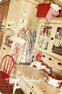 Love it! Love the pops of red, the aprons and the painted sideboard with hutch.