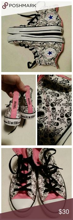 Converse All*Star high top Rebel skull sneakers Awesome Chuck Taylors. High tops in brand new condition. The name rebel is down the back strip of these and skulls are all over the shoes with a C under it. If these fit me I'd keep them. Converse Shoes Sneakers