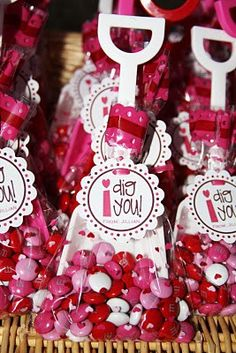 Adorable little plastic shovels and clear cellophane bags filled with candy of your choice and tied with a matching ribbon