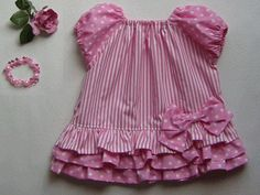 Pink peasant dress with ruffles and bow (in Japanese)