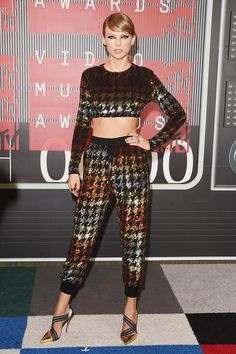 Taylor Swift wearing Christian Louboutin Pumpstagram Pumps and Ashish Joggers