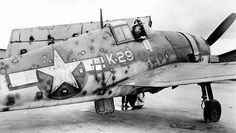 """Butch O'Hare's Hellcat returned to the Grumman manufacturing plant known as the """"Iron Works."""" It's combat aircraft were extremely rugged and brought many a pilot back home with considerable damage. This example had more than 200 bullet holes! Navy Aircraft, Ww2 Aircraft, Fighter Aircraft, Military Aircraft, Fighter Jets, Image Avion, Grumman F6f Hellcat, Photo Avion, Ww2 Pictures"""