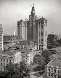"Circa 1913. ""New Municipal Building, New York City."" The 40-story Manhattan Municipal Building and associated infrastructure including an elevated rail line and the Manhattan Bridge"